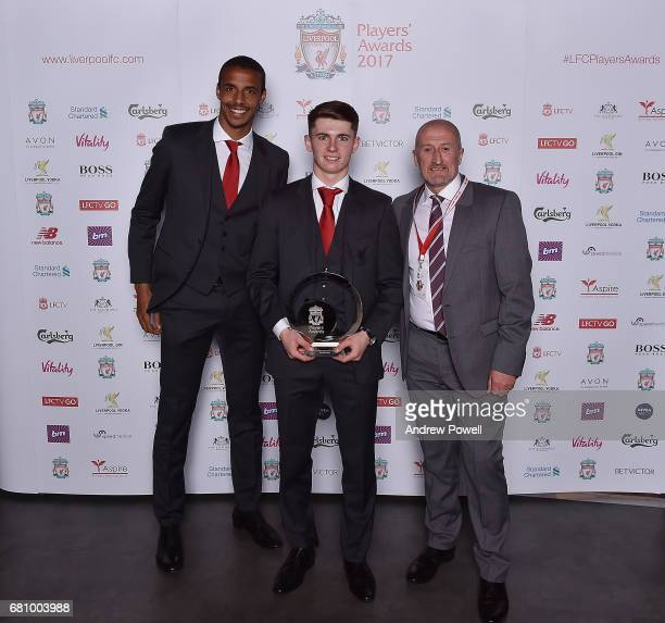 Ben Woodburn of Liverpool with team mate Joel Matip and Alan Nolan after winning Academy Player of the season award during the Liverpool FC Player...
