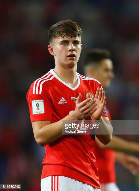 Ben Woodburn of Wales applauds the fans after victory in the FIFA 2018 World Cup Qualifier between Wales and Austria at Cardiff City Stadium on...