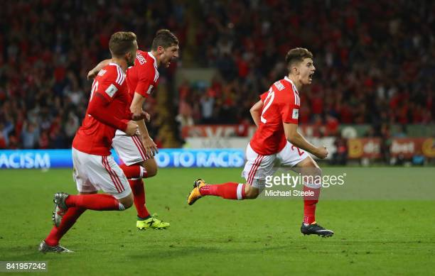 Ben Woodburn of Wales celebrates as he scores their first goal during the FIFA 2018 World Cup Qualifier between Wales and Austria at Cardiff City...