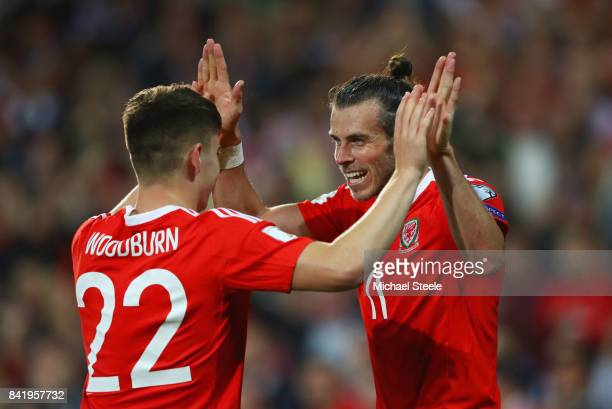 Ben Woodburn of Wales celebrates as he scores their first goal with Gareth Bale during the FIFA 2018 World Cup Qualifier between Wales and Austria at...