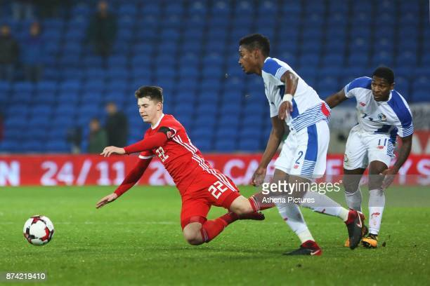 Ben Woodburn of Wales is challenged by Armando Cooper of Panama during the International Friendly match between Wales and Panama at The Cardiff City...