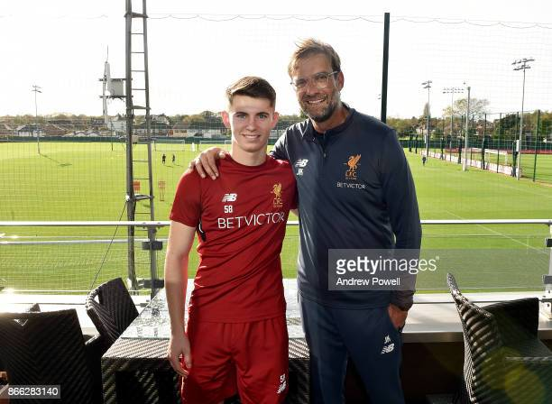 Ben Woodburn with Jurgen Klopp manager of Liverpool after signing a contract extension for Liverpool at Melwood Training Ground on October 25 2017 in...