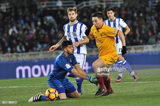 Ben Yedder of Sevilla CF duels for the ball with Geronimo Rulli of Real Sociedad during the Spanish league football match between Real Sociedad and...
