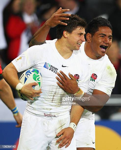 Ben Youngs and Manu Tuilagi of England celebrate after Youngs scored a try during the IRB 2011 Rugby World Cup Pool B match between England and...