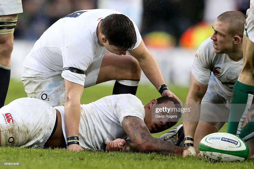 Ben Youngs of England attends to teammate Courtney Lawes after knocking himself unconcious making a tackle during the RBS Six Nations match between Ireland and England at Aviva Stadium on February 10, 2013 in Dublin, Ireland.
