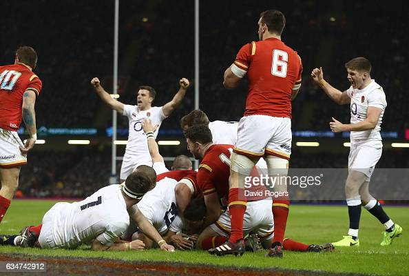 Ben Youngs of England burrows over to score the oipening try during the RBS Six Nations match between Wales and England at the Principality Stadium...