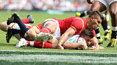 Ben Youngs of England dives over to score their third try during the England v Wales International match at Twickenham Stadium on May 29 2016 in...