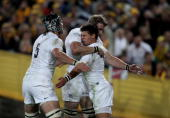 Ben Youngs of England is congratulated by team mates Tom Palmer and Tom Croft after scoring the first try during the Cook Cup Test Match between the...