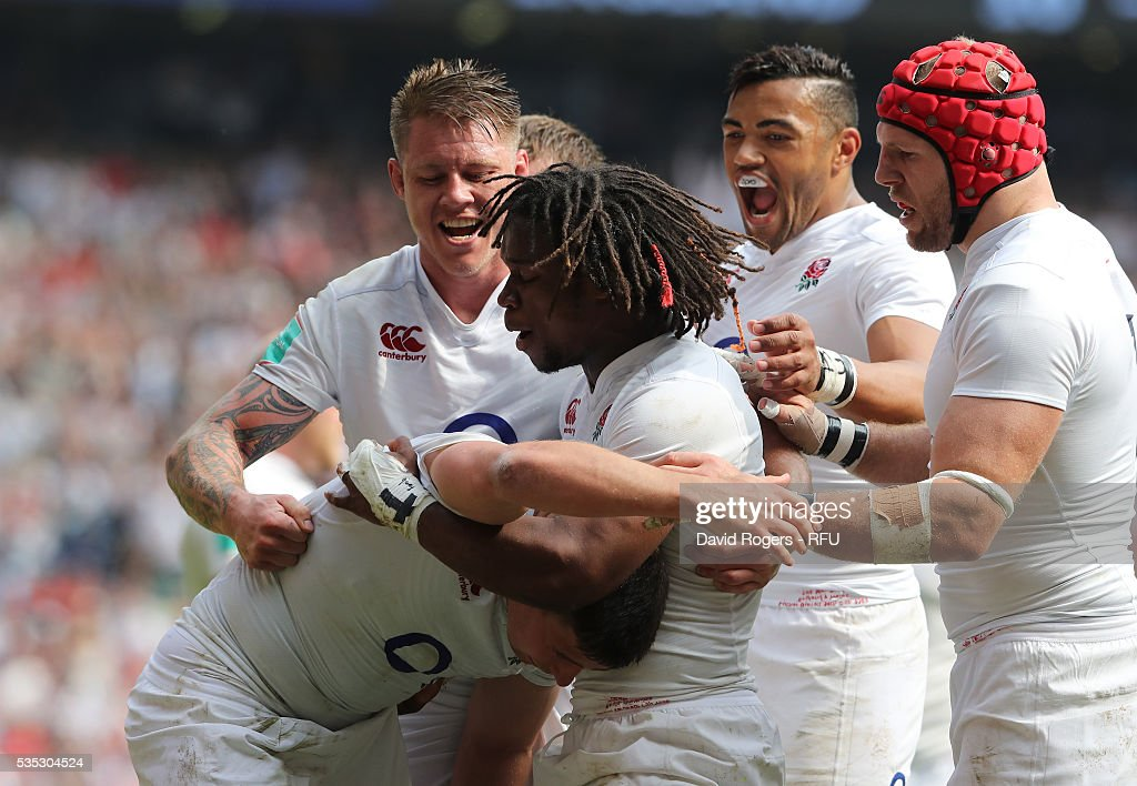 <a gi-track='captionPersonalityLinkClicked' href=/galleries/search?phrase=Ben+Youngs&family=editorial&specificpeople=3970947 ng-click='$event.stopPropagation()'>Ben Youngs</a> of England is mobbed by team mates after scoring their third try during the England v Wales International match at Twickenham Stadium on May 29, 2016 in London, England.