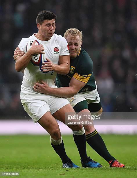 Ben Youngs of England is tackled by Vincent Koch of South Africa during the Old Mutual Wealth Series match between England and South Africa at...