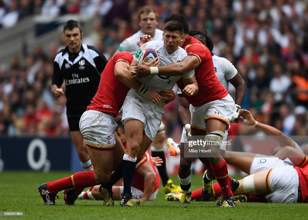 <a gi-track='captionPersonalityLinkClicked' href=/galleries/search?phrase=Ben+Youngs&family=editorial&specificpeople=3970947 ng-click='$event.stopPropagation()'>Ben Youngs</a> of England is wrapped up by the Welsh defence during the Old Mutual Wealth Cup between England and Wales at Twickenham Stadium on May 29, 2016 in London, England.