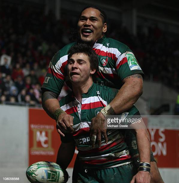 Ben Youngs of Leicester celebrates scoring his sides second try with Alesana Tuilagi during the Heineken Cup Pool Five match between Scarlets and...