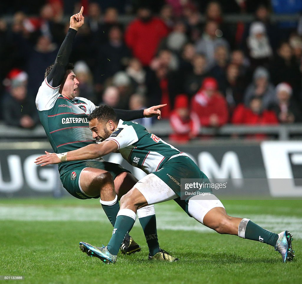 Ben Youngs (L) of Leicester celebrates with team mate Telusa Veainu after scoring their third try during the European Rugby Champions Cup match between Munster and Leicester Tigers at Thomond Park on December 12, 2015 in Limerick, Ireland.