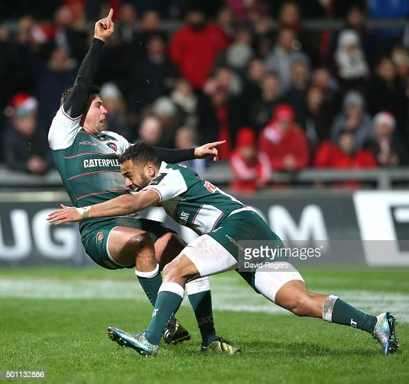 Ben Youngs of Leicester celebrates with team mate Telusa Veainu after scoring their third try during the European Rugby Champions Cup match between...