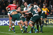 Ben Youngs of Leicester celebrates with team mates after scoring their third try during the European Rugby Champions Cup match between Munster and...