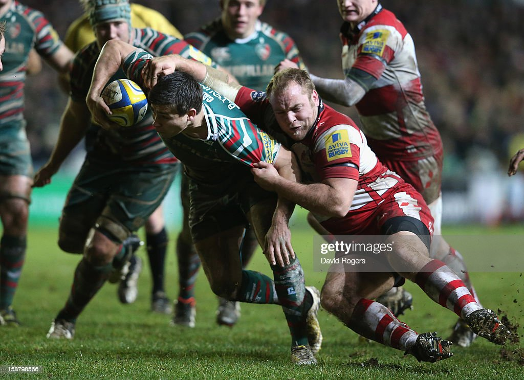 <a gi-track='captionPersonalityLinkClicked' href=/galleries/search?phrase=Ben+Youngs&family=editorial&specificpeople=3970947 ng-click='$event.stopPropagation()'>Ben Youngs</a> of Leicester is tackled by Dario Christolini during the Aviva Premiership match between Leicester Tigers and Gloucester at Welford Road on December 29, 2012 in Leicester, England.