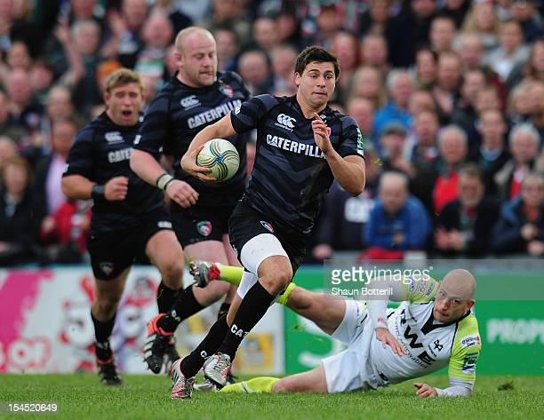 Ben Youngs of Leicester Tigers breaks through the tackle of Richard Fussell of Ospreys during the Heineken Cup Round 2 match between Leicester Tigers...