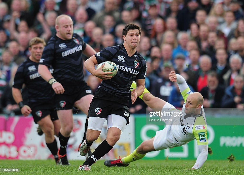 <a gi-track='captionPersonalityLinkClicked' href=/galleries/search?phrase=Ben+Youngs&family=editorial&specificpeople=3970947 ng-click='$event.stopPropagation()'>Ben Youngs</a> of Leicester Tigers breaks through the tackle of Richard Fussell of Ospreys during the Heineken Cup Round 2 match between Leicester Tigers and Ospreys at Welford Road on October 21, 2012 in Leicester, England.