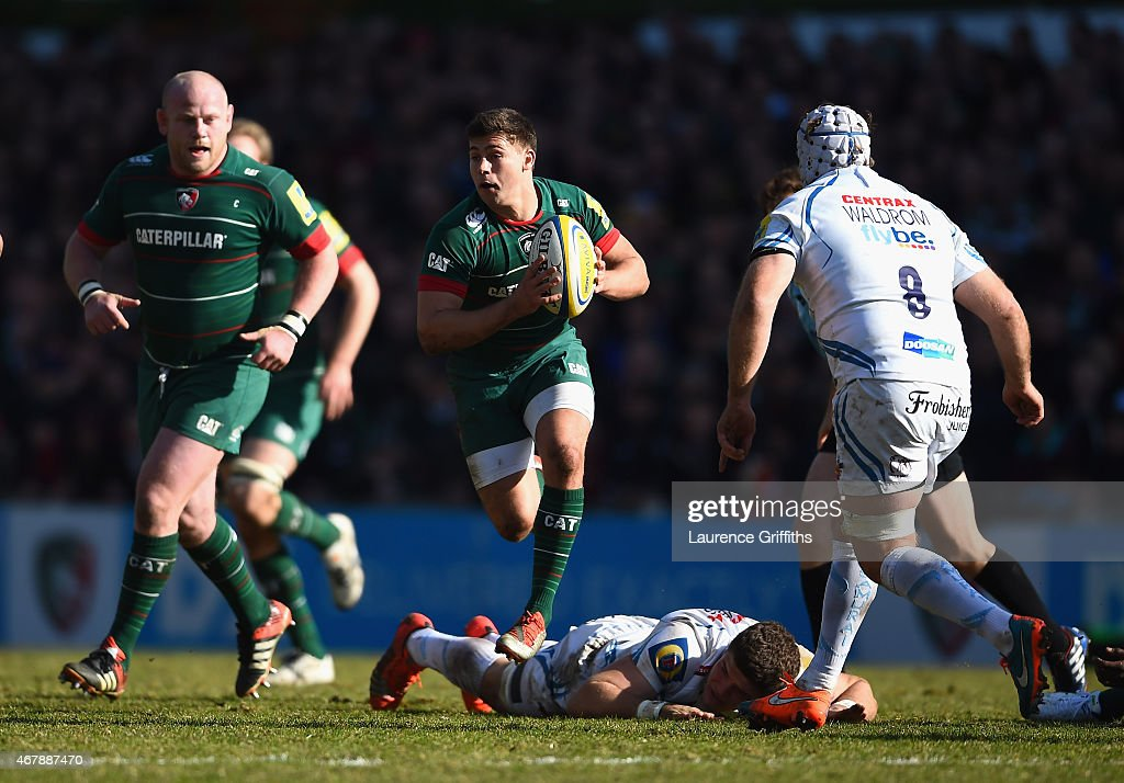 Ben Youngs of Leicester Tigers dances through the Exeter tackles during the Aviva Premiership match between Leicester Tigers and Exeter Chiefs at Welford Road on March 28, 2015 in Leicester, England.