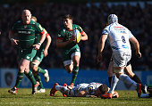 Ben Youngs of Leicester Tigers dances through the Exeter tackles during the Aviva Premiership match between Leicester Tigers and Exeter Chiefs at...