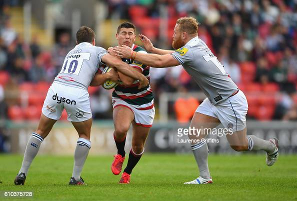Ben Youngs of Leicester Tigers is tackles by George Ford and Ross Batty of Bath Rugby during the Aviva Premiership match between Leicester Tigers and...