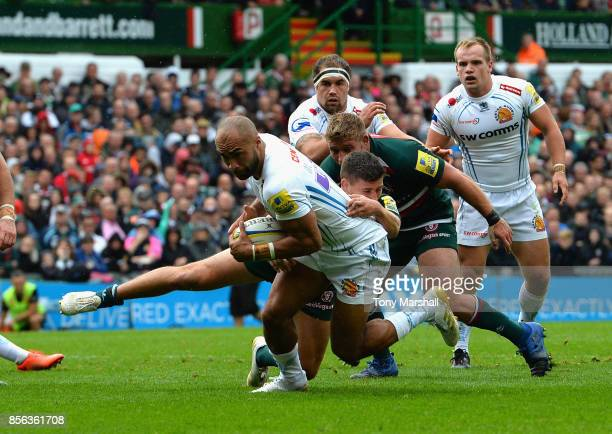 Ben Youngs of Leicester Tigers tackles Olly Woodburn of Exeter Chiefs during the Aviva Premiership match between Leicester Tigers and Exeter Chiefs...