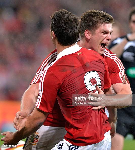 Ben Youngs of the Lions celebrates with Owen Farrell after scoring a try during the match between the Queensland Reds and the British Irish Lions at...