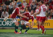 Ben Youngs of the Lions celebrates with team mate Owen Farrell after scoring a try during the match between the Queensland Reds and the British Irish...