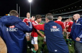 Ben Youngs of the Lions is congratulated by backs coach Rob Howley after making his Lions debut during the tour match between the Western Force and...