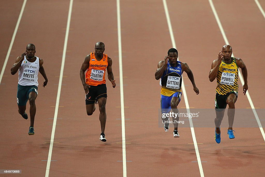 Ben Youssef Meite of Cote d'Ivoire Churandy Martina of the Netherlands Ramon Gittens of Barbados and Asafa Powell of Jamaica compete in the Men's 100...