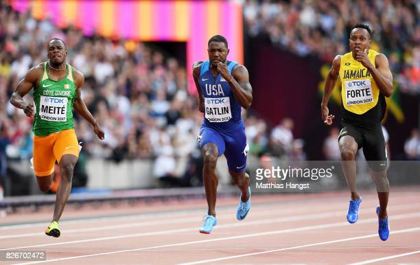 Ben Youssef Meite of Cote d'Ivoire Justin Gatlin of the United States and Julian Forte of Jamaica competes in the Men's 100 metres semifinals during...