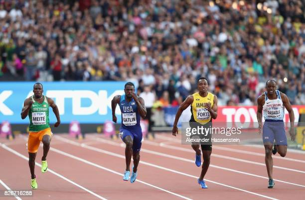 Ben Youssef Meite of Cote d'Ivoire Justin Gatlin of the United States Julian Forte of Jamaica James Dasaolu of Great Britain competes in the Men's...