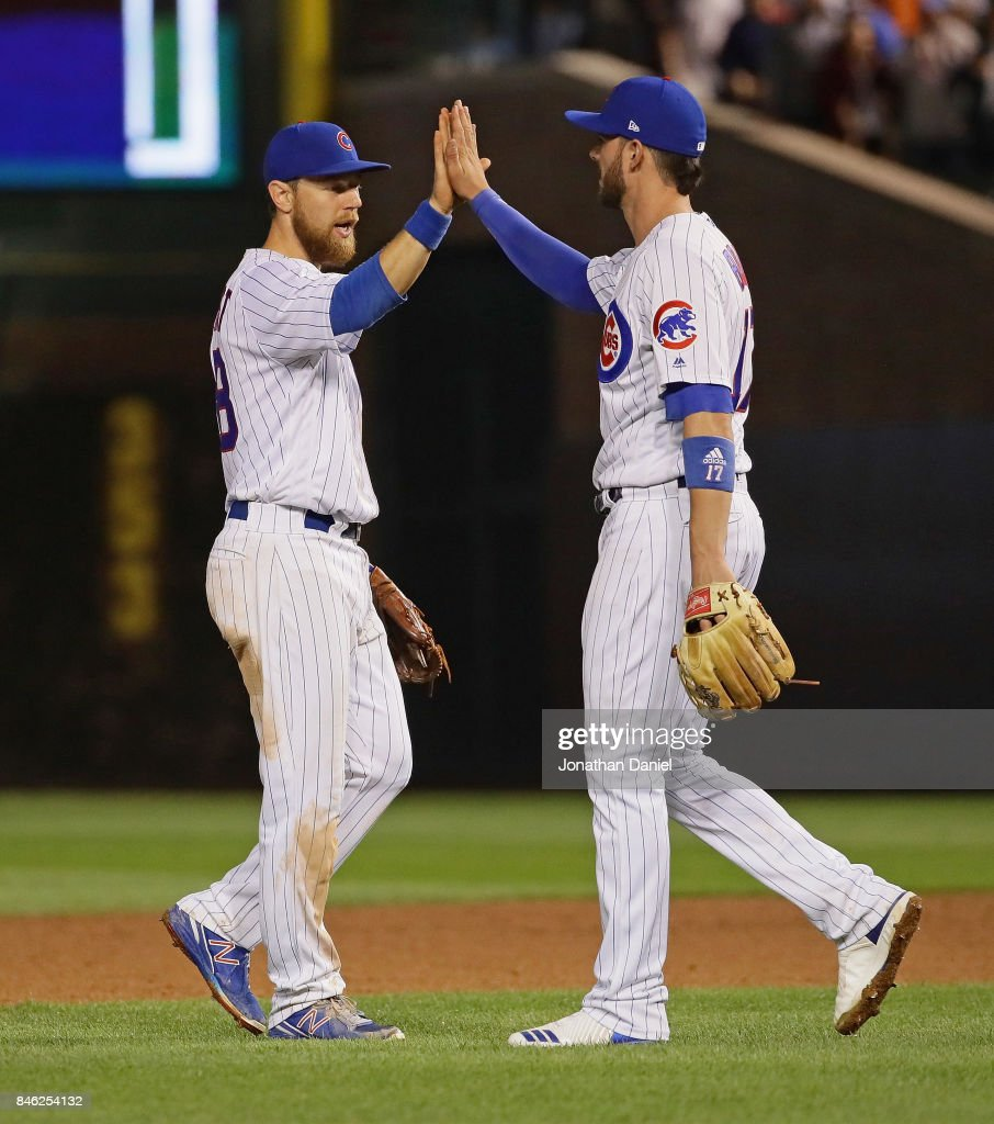 Ben Zobrist #18 (L) and Kris Bryant #17 of the Chicago Cubs celebrate a win over the New York Mets at Wrigley Field on September 12, 2017 in Chicago, Illinois. The Cubs defeated the Mets 8-3.