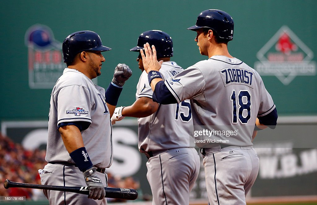 Ben Zobrist #18 celebrates a run with Jose Molina #28 of the Tampa Bay Rays against the Boston Red Sox during Game Two of the American League Division Series at Fenway Park on October 5, 2013 in Boston, Massachusetts.