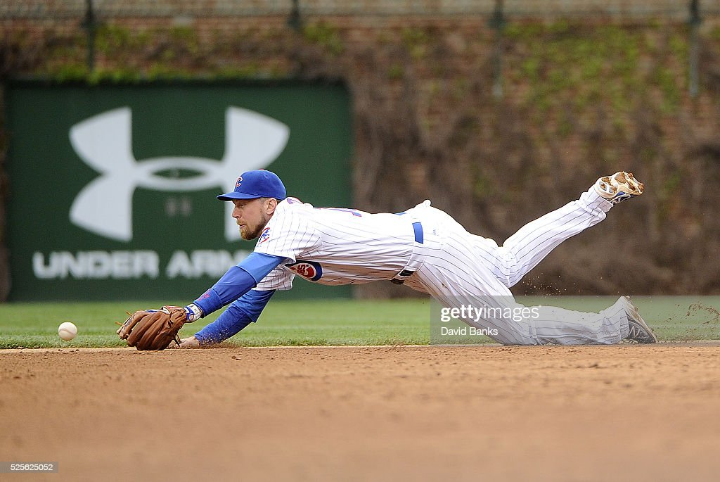 Ben Zobrist #18 of the Chicago Cubs can't make a play on a single off the bat of Hernan Perez of the Milwaukee Brewers during the seventh inning on April 28, 2016 at Wrigley Field in Chicago, Illinois.