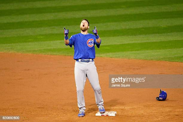 Ben Zobrist of the Chicago Cubs celebrates after he hits a RBI double in the 10th inning against the Cleveland Indians in Game Seven of the 2016...