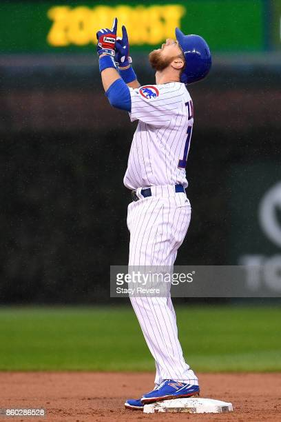 Ben Zobrist of the Chicago Cubs celebrates after hitting a double in the second inning during game four of the National League Division Series...