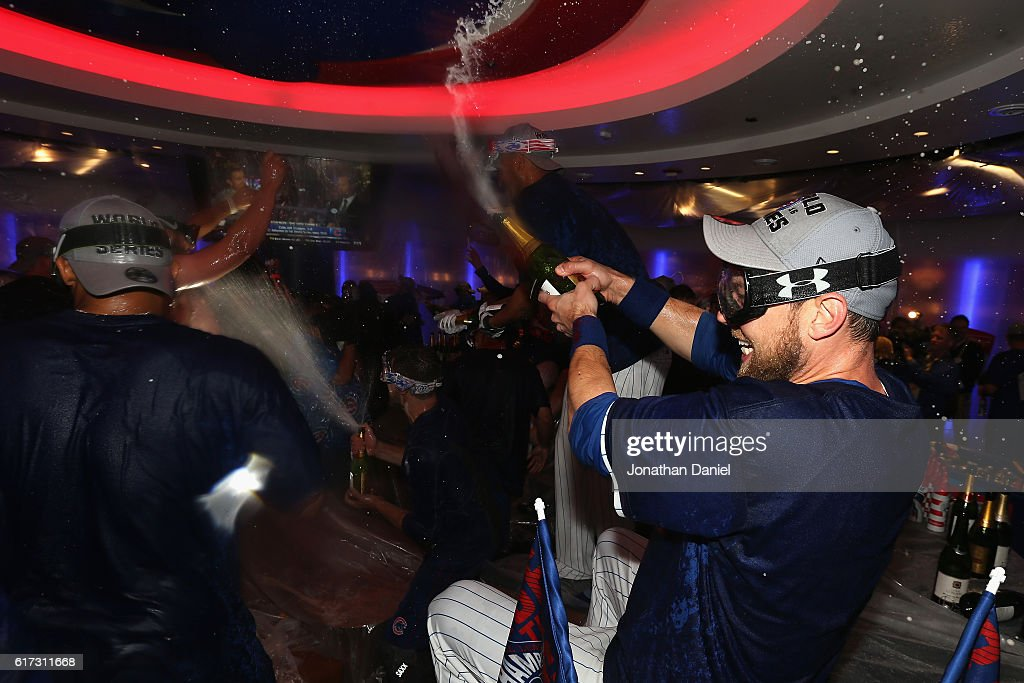 Ben Zobrist #18 of the Chicago Cubs celebrates in the clubhouse after defeating the Los Angeles Dodgers 5-0 in game six of the National League Championship Series to advance to the World Series against the Cleveland Indians at Wrigley Field on October 22, 2016 in Chicago, Illinois.