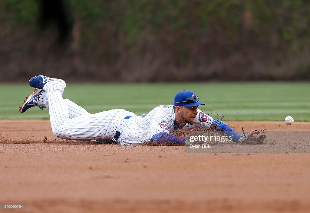 <a gi-track='captionPersonalityLinkClicked' href=/galleries/search?phrase=Ben+Zobrist&family=editorial&specificpeople=2120037 ng-click='$event.stopPropagation()'>Ben Zobrist</a> #18 of the Chicago Cubs dives for a ground ball in the second inning against the Atlanta Braves at Wrigley Field on April 29, 2016 in Chicago, Illinois.