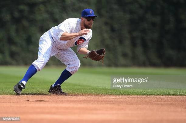 Ben Zobrist of the Chicago Cubs fields a ground ball during a game against the Toronto Blue Jays at Wrigley Field on August 20 2017 in Chicago...