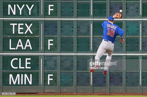 Ben Zobrist of the Chicago Cubs fields a line drive off the score board in center field in the sixth inning against the Houston Astros at Minute Maid...