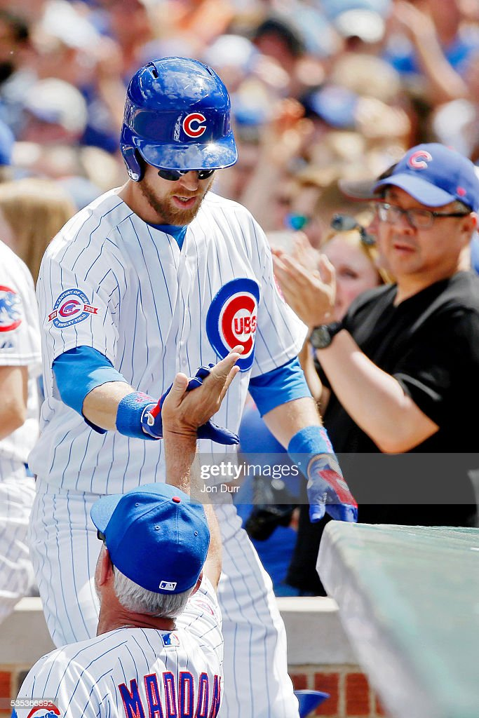<a gi-track='captionPersonalityLinkClicked' href=/galleries/search?phrase=Ben+Zobrist&family=editorial&specificpeople=2120037 ng-click='$event.stopPropagation()'>Ben Zobrist</a> #18 of the Chicago Cubs is congratulated by manager <a gi-track='captionPersonalityLinkClicked' href=/galleries/search?phrase=Joe+Maddon&family=editorial&specificpeople=568433 ng-click='$event.stopPropagation()'>Joe Maddon</a> #70 after hitting a three run home run against the Philadelphia Phillies during the third inning at Wrigley Field on May 29, 2016 in Chicago, Illinois.