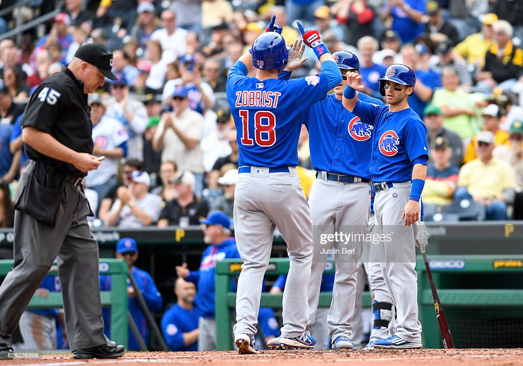<a gi-track='captionPersonalityLinkClicked' href=/galleries/search?phrase=Ben+Zobrist&family=editorial&specificpeople=2120037 ng-click='$event.stopPropagation()'>Ben Zobrist</a> #18 of the Chicago Cubs is greeted by teammates as he crosses home plate after hitting a three run home run in the third inning during the game against the Pittsburgh Pirates at PNC Park on May 4, 2016 in Pittsburgh, Pennsylvania.
