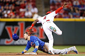 Ben Zobrist of the Chicago Cubs is tagged out trying to steal second base against Brandon Phillips of the Cincinnati Reds in the eighth inning of the...