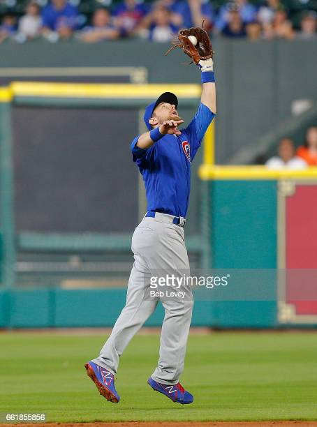 Ben Zobrist of the Chicago Cubs makes a catch in the second inning against the Houston Astros during an exhibition game at Minute Maid Park on March...