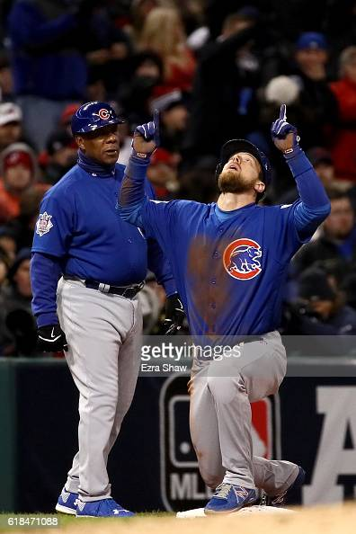 Ben Zobrist of the Chicago Cubs reacts at third base after hitting an RBI triple to score Anthony Rizzo during the fifth inning against the Cleveland...