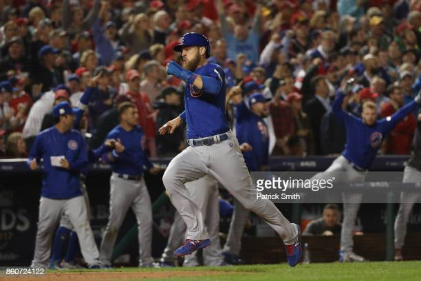 Ben Zobrist of the Chicago Cubs runs into home on a double hit by Addison Russell of the Chicago Cubs against the Washington Nationals during the...