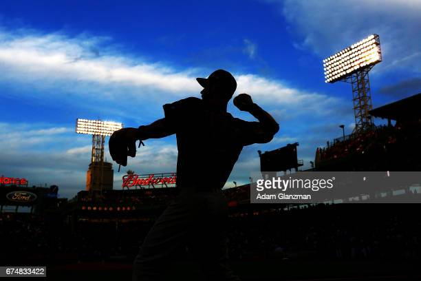 Ben Zobrist of the Chicago Cubs warms up before the game against the Boston Red Sox at Fenway Park on April 28 2017 in Boston Massachusetts