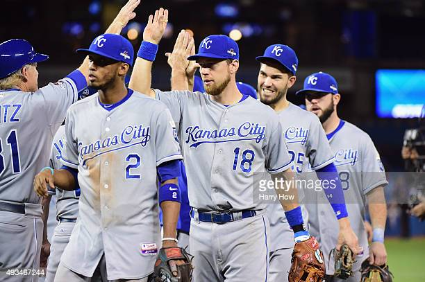 Ben Zobrist of the Kansas City Royals celebrates a 142 win over the Toronto Blue Jays between Alcides Escobar and Eric Hosmer during game four of the...