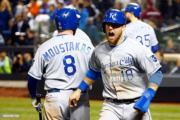 Ben Zobrist of the Kansas City Royals celebrates after scoring a run off of a two run RBI double hit by Lorenzo Cain to also scoring Alcides Escobar...